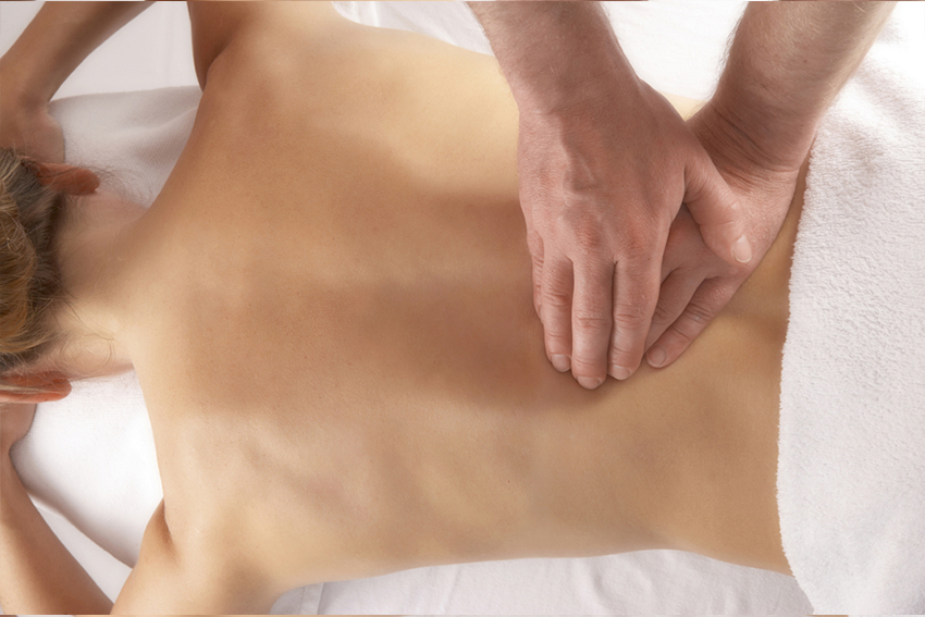massage of the lower back on white linen